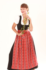 Bayerische Frau mit duftender Blume