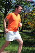man running in a park in summer