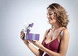 smiling woman open gift box