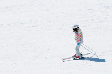 Little girl skiing - space for text