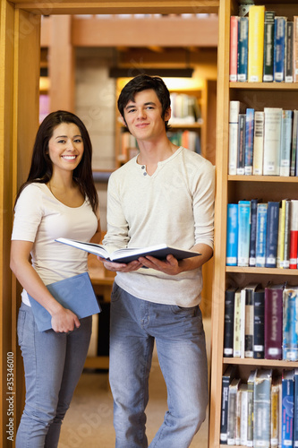 Portrait of students holding books