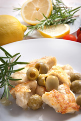 Breaded chicken breast with green olives