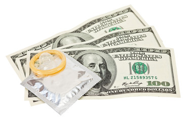 Condom with money on white