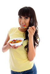 Smiling woman eating cereal breakfast
