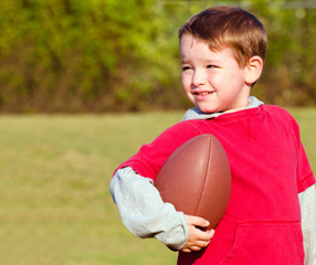 Young boy with football