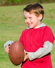 Young boy or kid with football