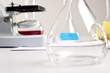lab flasks, tubes, microscope, lab workplace
