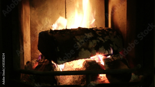 Flame burning in a fireplace with a dark background