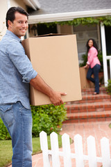 Hispanic couple moving into new house