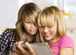 Teenage girls using touchpad