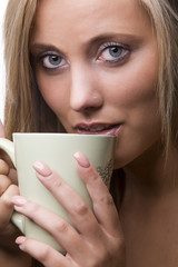 young woman with cup of beverage