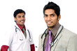 Indian young doctors posing to the camera.