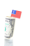 US flag and a dollar bill on white