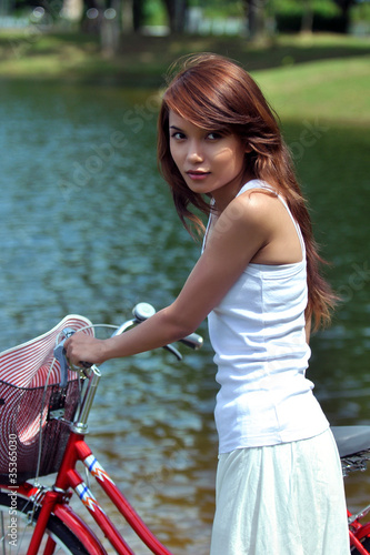 pretty girl with bicycle at the park