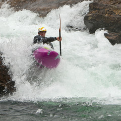 Kayaker in the waterfall