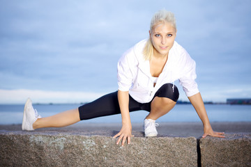 Beautiful woman doing stretching exercise