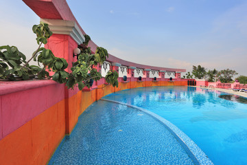 Pink walls and blue water. The luxurious pool