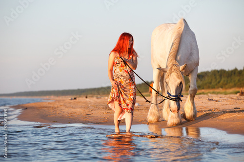 Sunset with horse at the beach