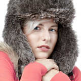 Beautiful winter lady with pelt cap feeling cold poster