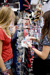 Two teenage girls looking at postcards in a souvenir shop