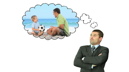 Businessman thinking about moments with his family