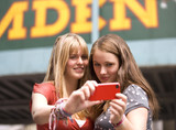 Two teenage girls taking a photograph of themselves