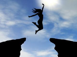Frau springt über Schlucht - Silhouette - day