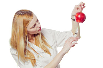 woman doctor with apple and syringe