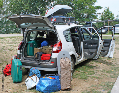 family car loaded with luggage going on holiday
