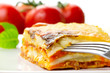 Italian lasagna dish with tomatoes