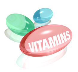 Vitamins on White Background and Word on Capsule