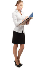 Business woman writing in documents