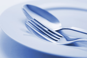 Fork and Spoon on Plate.