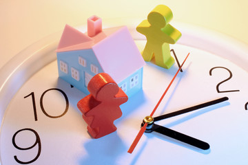 Figures and Toy House on Clock