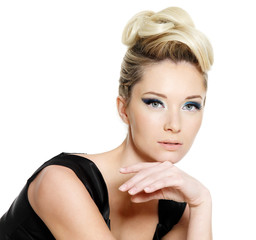Glamour woman with blue eye make-up and curly hairstyle