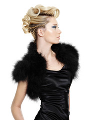 Glamour woman in black fur dress with modern  hairstyle