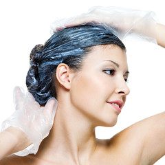 beautiful young woman dyeing hairs