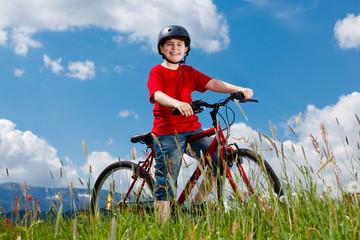 Cyclist - boy riding bike