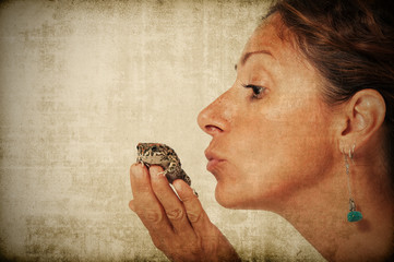 Frog prince kissed by a beautiful woman.