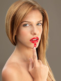 young blonde woman smudging her lipstick poster