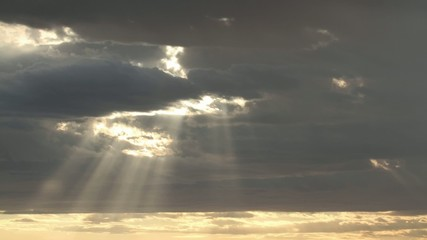 Time lapse of dramatic clouds and rays of sunlight