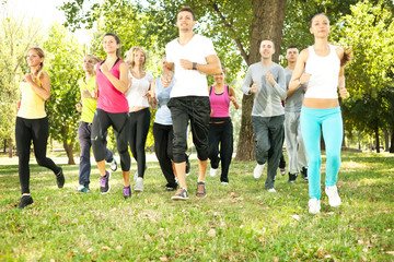 large group jogging in park