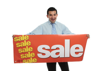 Excited man  holding a Sale sign