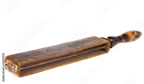 old razor strop isolated on white background