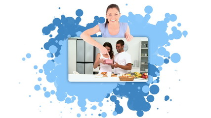 Young woman pointing at a couple in a kitchen