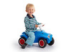 Leinwanddruck Bild - Kleinkind fährt mit dem Bobby Car