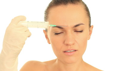 Attractive woman inject herself botox in face, isolated