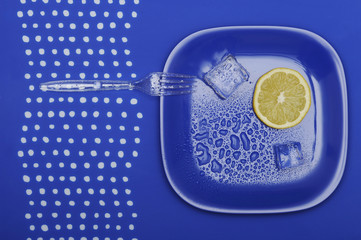 Fresh lemon on the blue plate