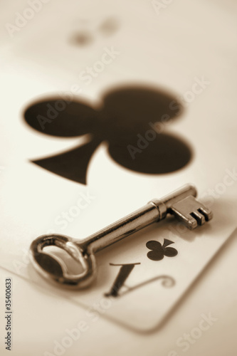Key on playing card.