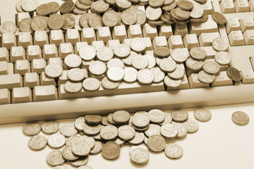 Coins on Computer Keyboard